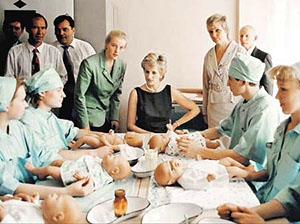 Britain's Princess of Wales talks to paediatric nurses who are learning medical skills on rubber baby models during a visit by the Princess Friday June 16, 1995 to the Tushinskaya Children's Hospital in Moscow. Princess Diana, who is patron of the hospital's Trust, is on a two day official visit to the Russian capital. (AP Photo/pool)